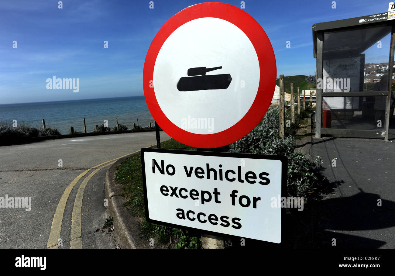 A defaced no vehicles except for access sign, with the car being replaced by a tank off the coast road at Saltdean - Stock Image