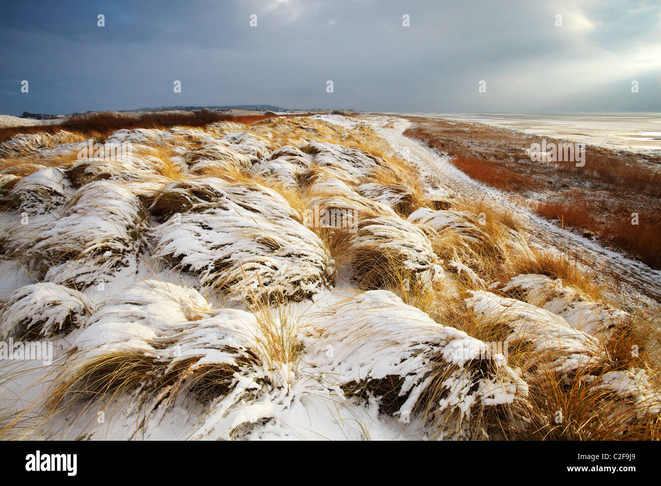 Snow covers the beach at Red Rocks. Hoylake, Wirral, Merseyside, UK - Stock Image