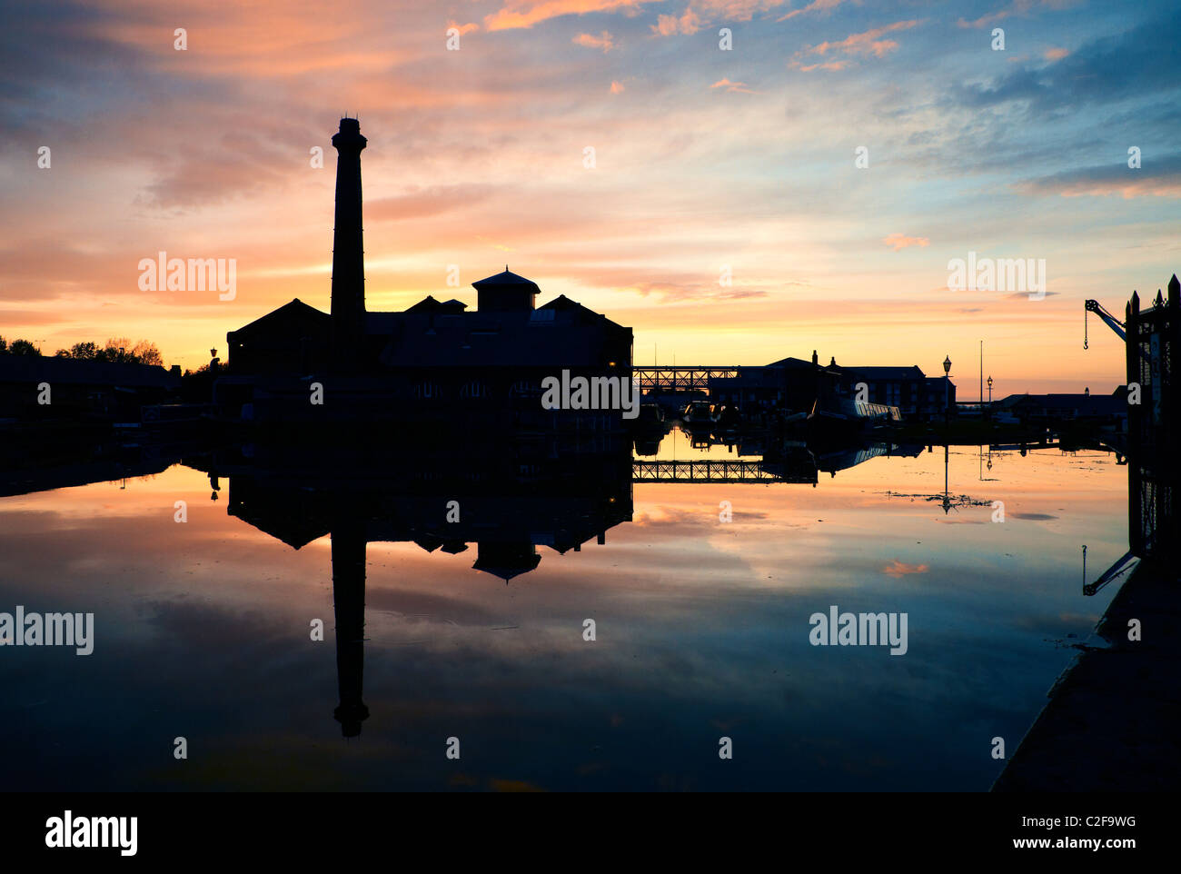 Ellesmere Port Boat Museum silhouetted during a colourful sunset - Stock Image