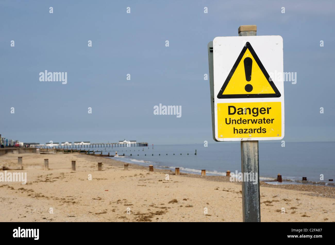 Danger underwater hazards sign, Southwold, Suffolk, UK. - Stock Image