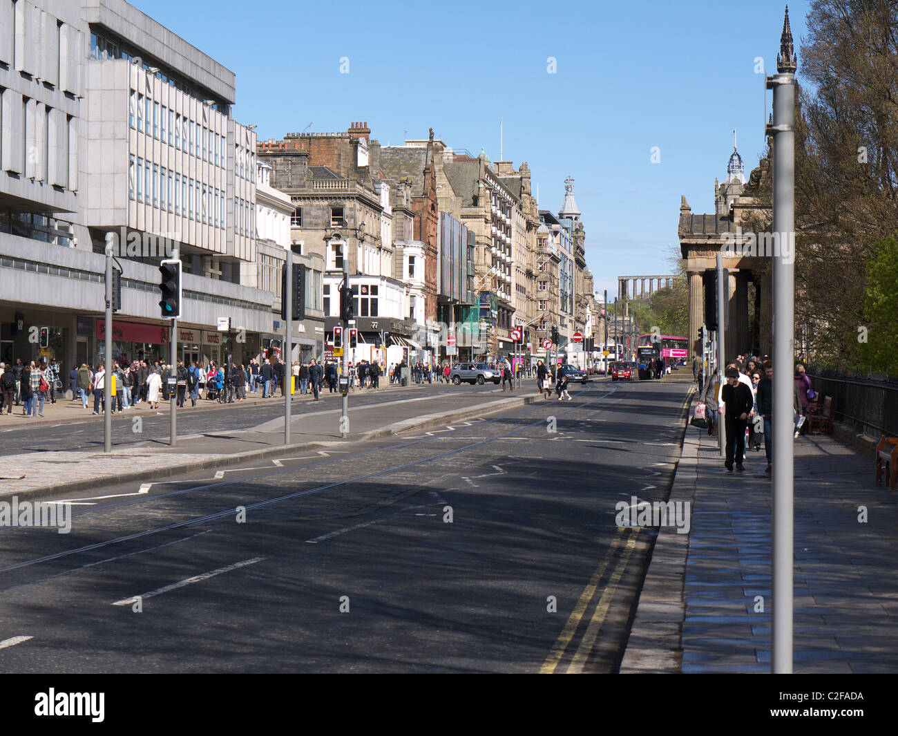 A view looking East along Princes Street, Edinburgh, Scotland, UK, with Calton Hill in the background - Stock Image