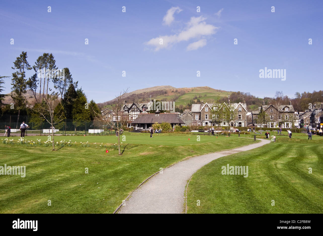 Ambleside, Cumbria, England, UK, Britain. View of the Cumbrian town from across the park putting green - Stock Image