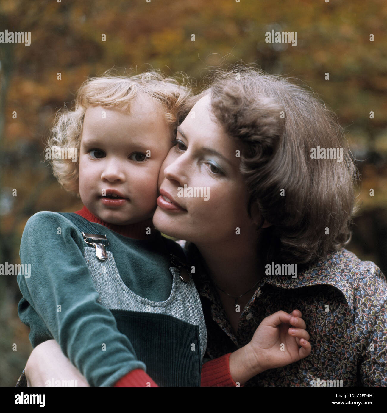 Seventies, people, family, mother and daughter cheek to cheek, portrait, 25 to 35 years, aged 4 to 6 years, Ursula, - Stock Image