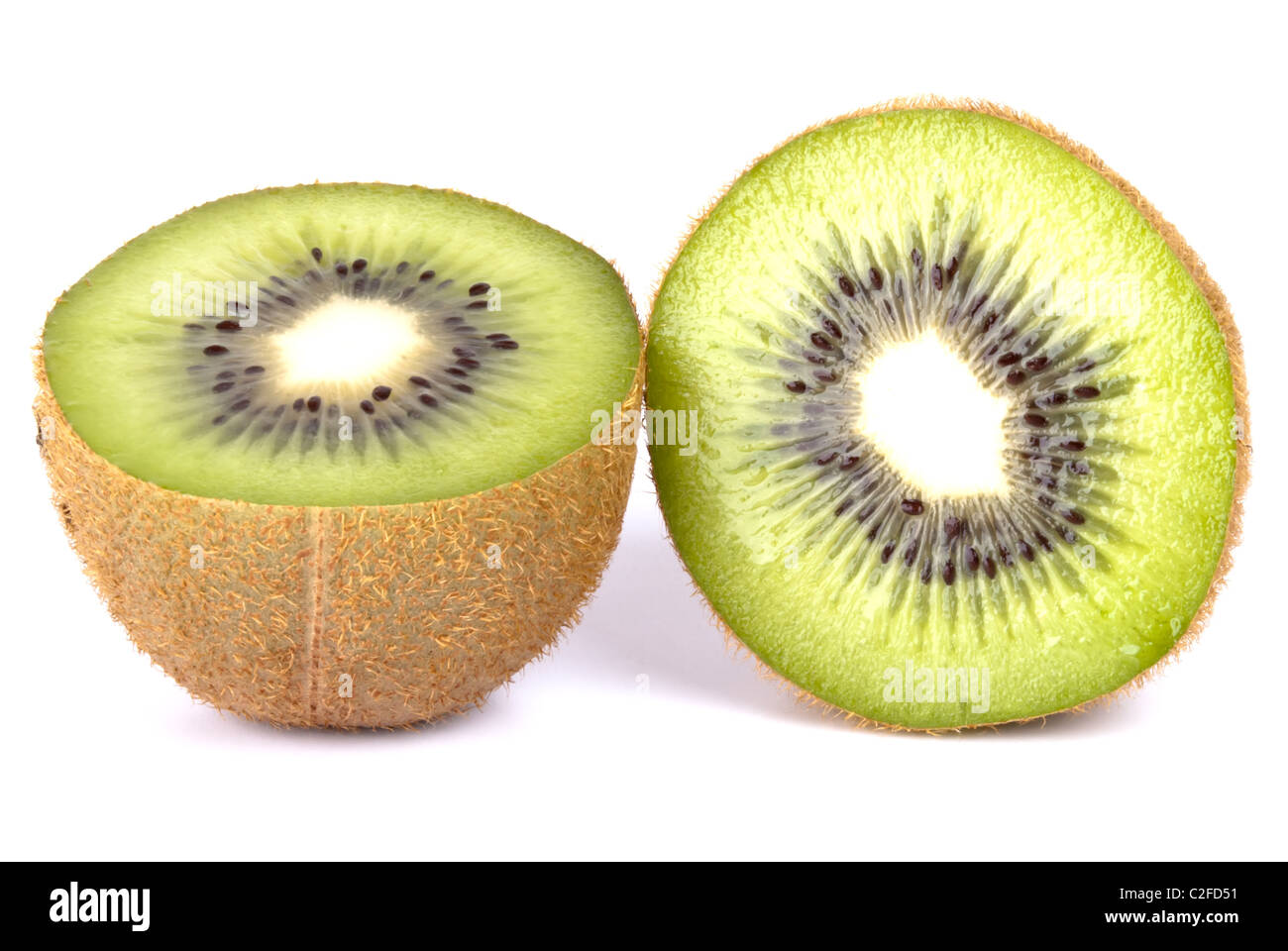 Kiwi two halves exempted from white background - Stock Image