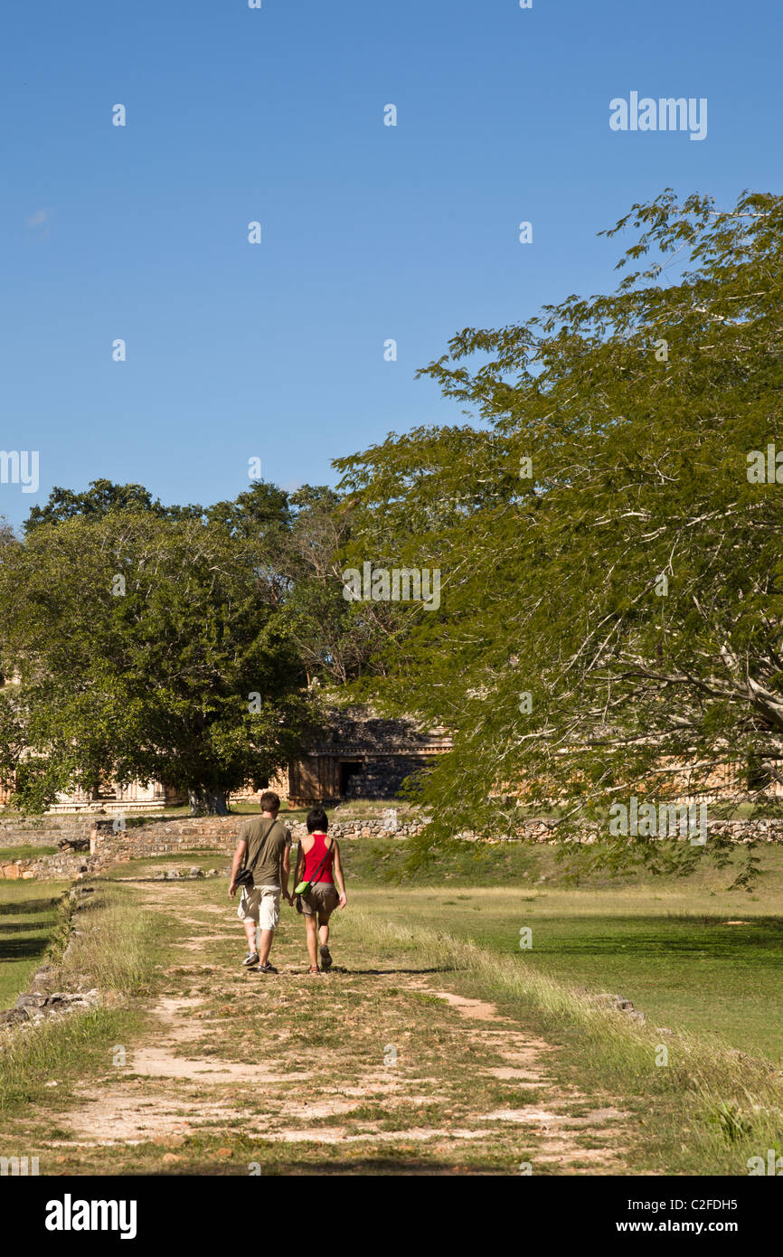Couple walking together along the sacbe at the Maya ruins of Labna along the Puuc Route in the Yucatan Peninsula, - Stock Image