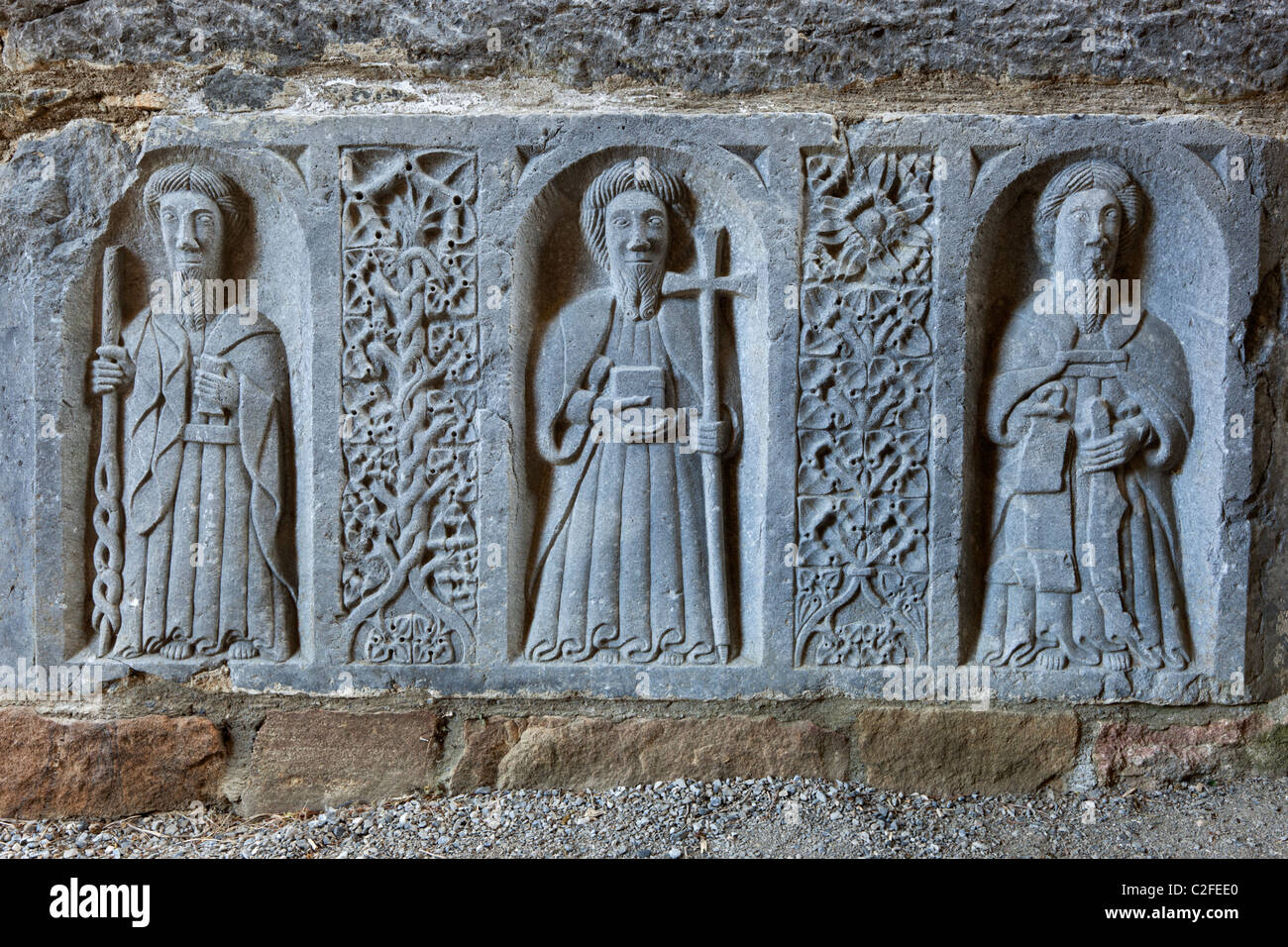 Tomb carvings inside 12th century Cistercian Romanesque church - Stock Image