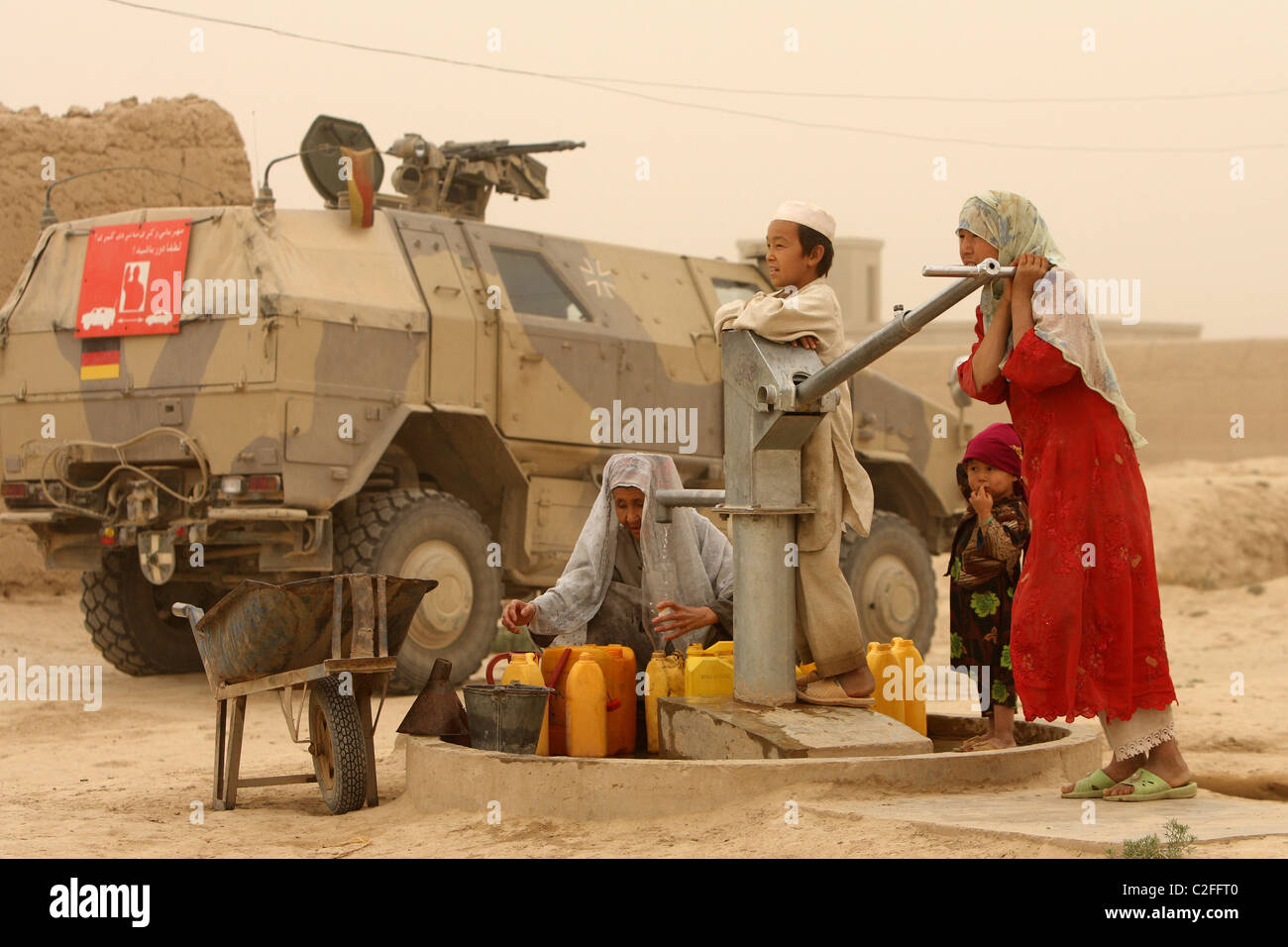 Locals pumping water from a water pump, Kunduz, Afghanistan - Stock Image