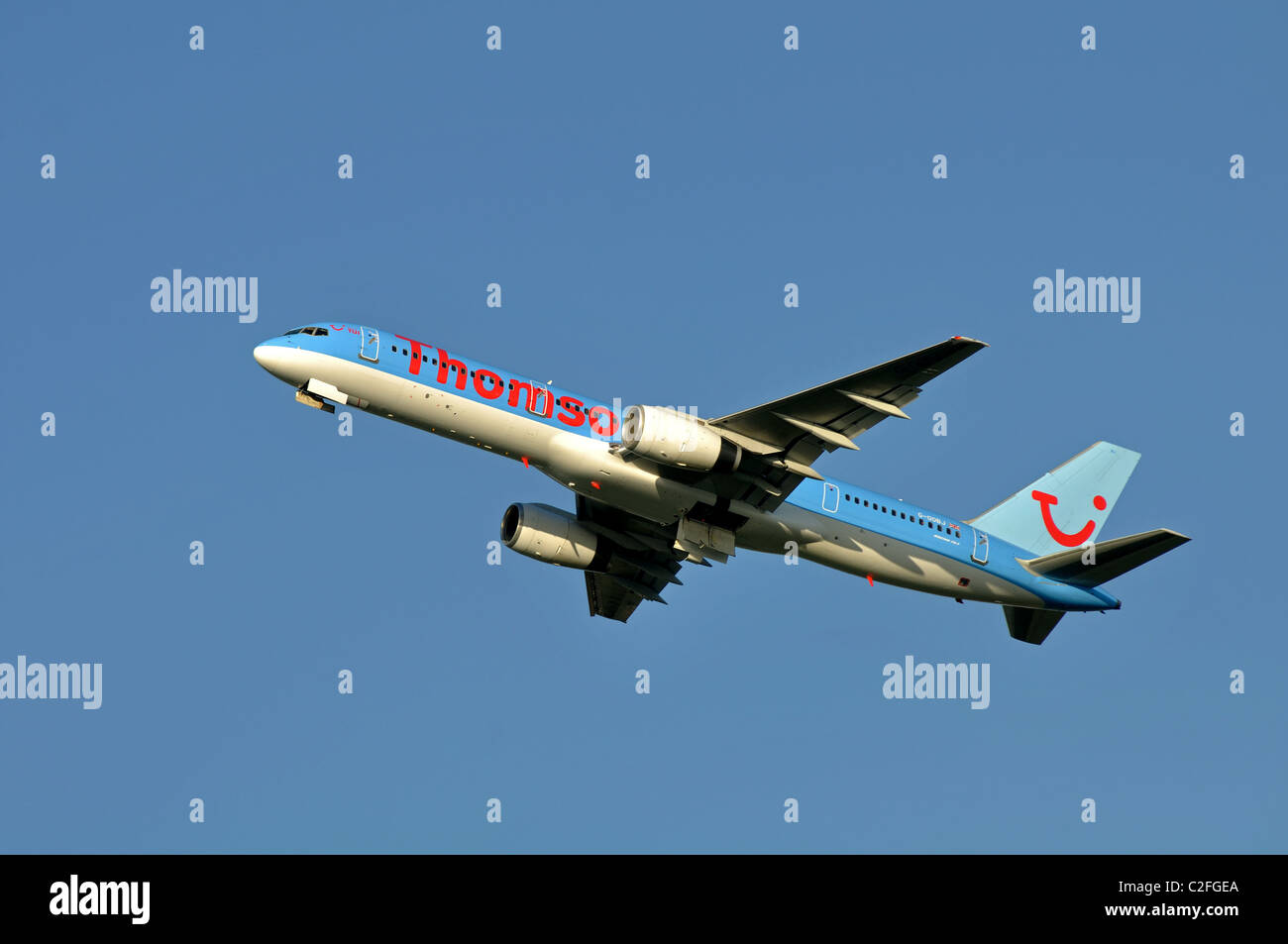 Thomson Boeing 757 aircraft taking off at Birmingham Airport, UK Stock Photo