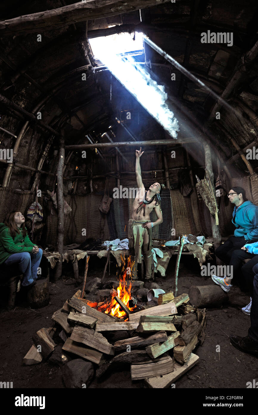 Plimouth Plantation. Brave talks about native people's lives in 1600's in recreated Wampanoag village Stock Photo