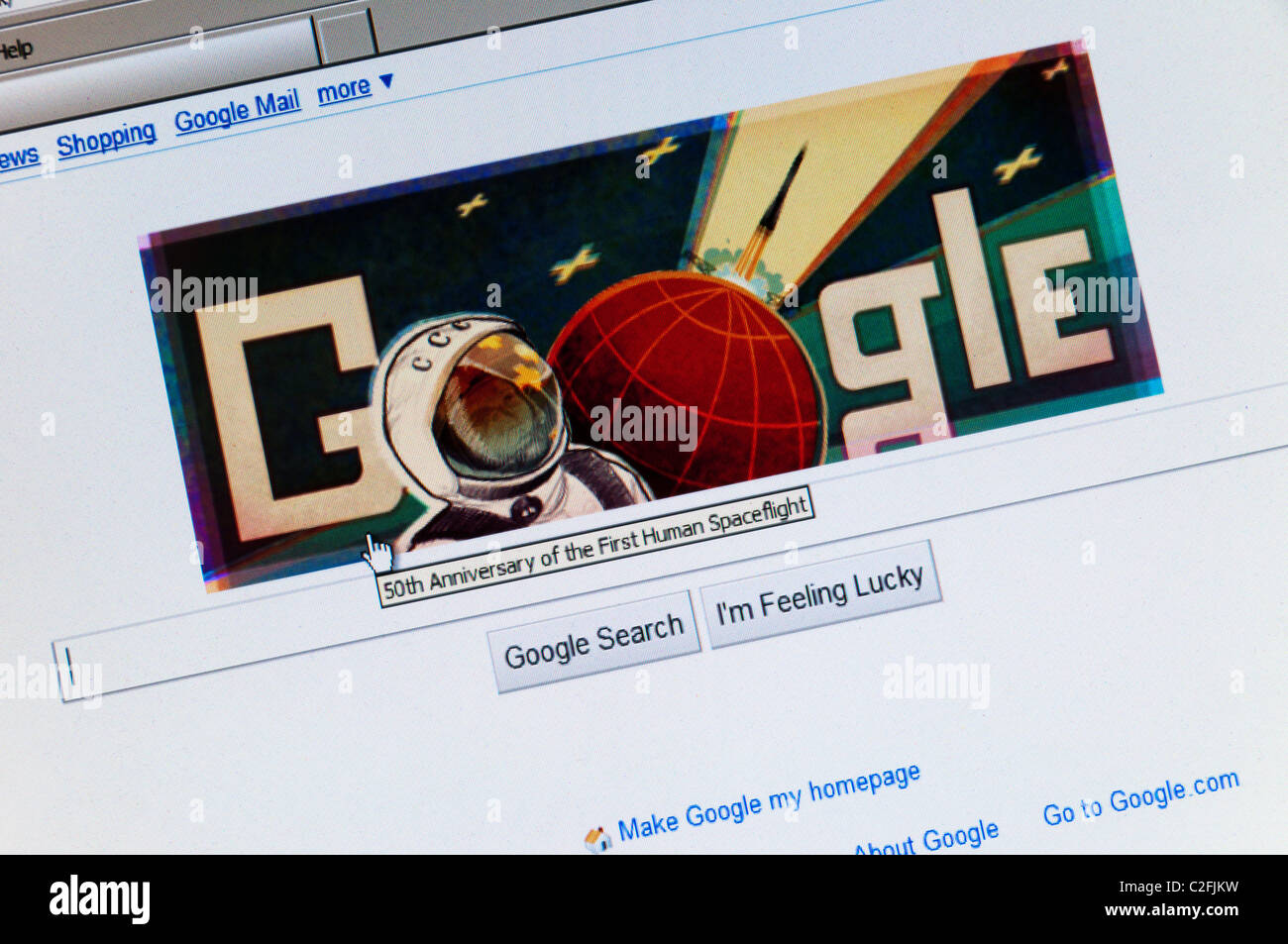 The Google search engine web site front page celebrating the 50th anniversary of the first human spaceflight by - Stock Image