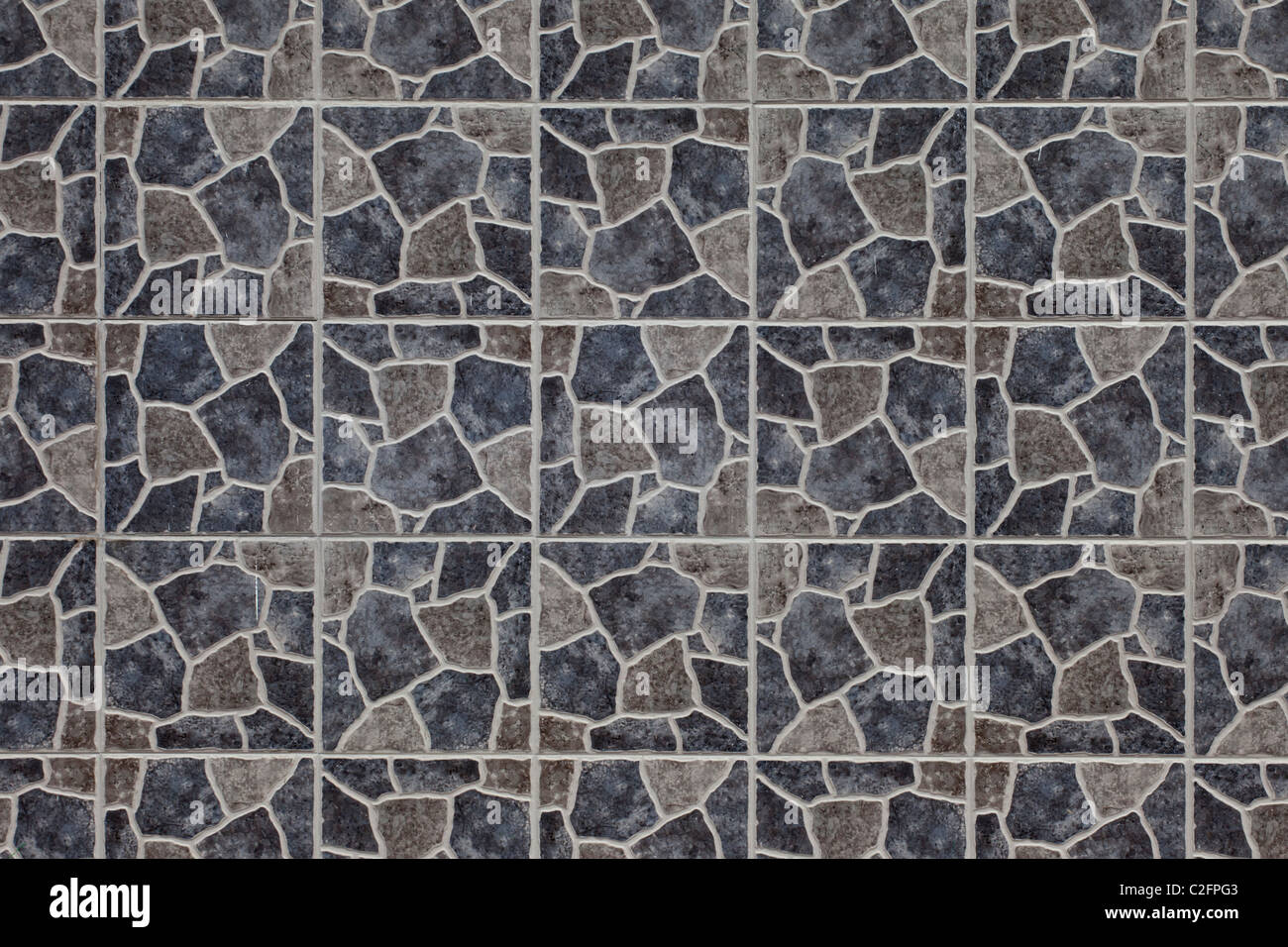 A wall tile texture in muted grey and brown colours - Stock Image