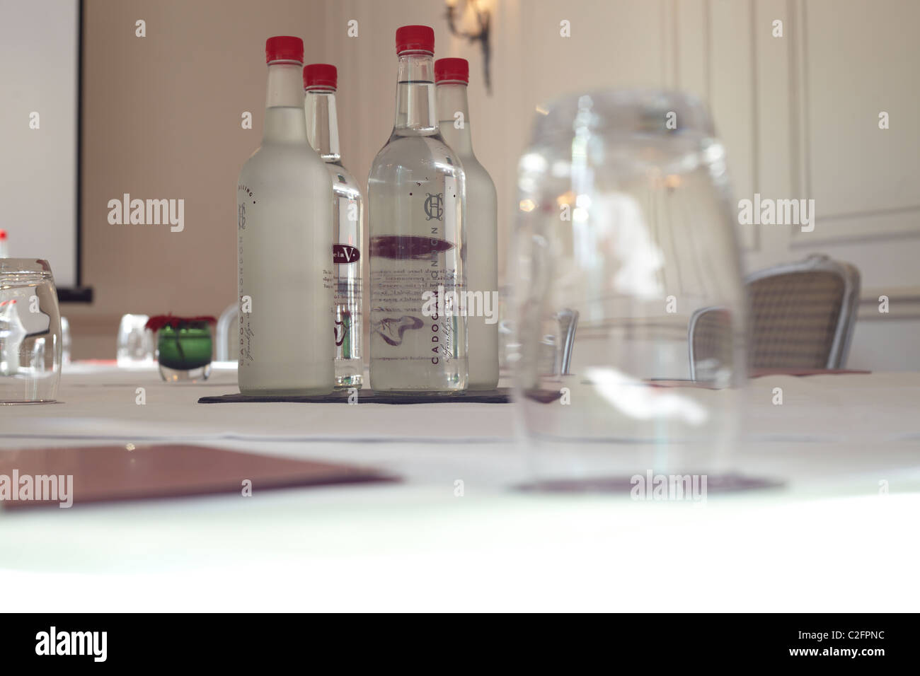 Glass and water bottles in conference room - Stock Image