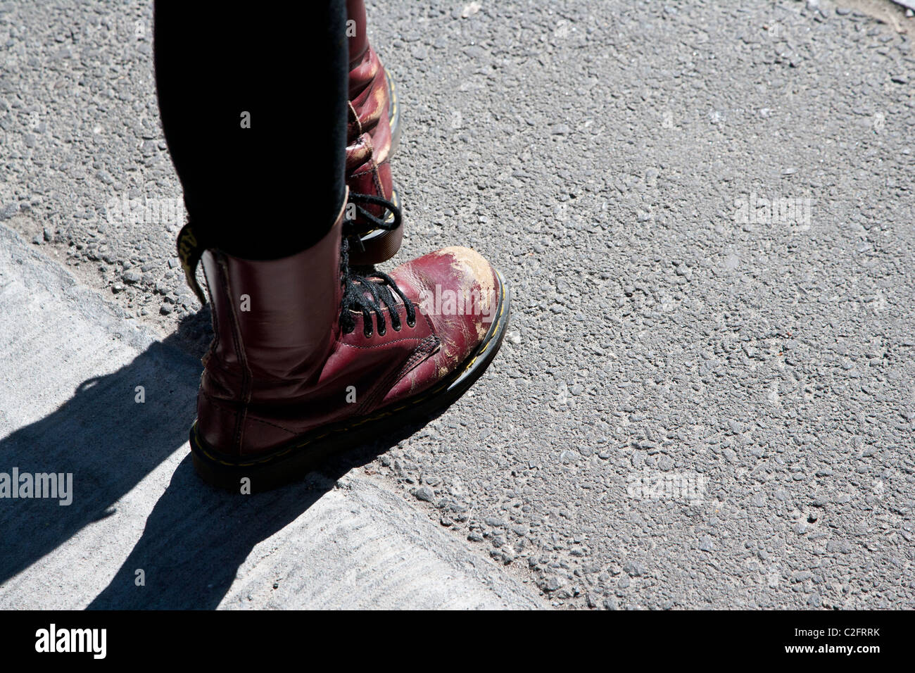 A scuffed pair of red doctor martin boots - Stock Image