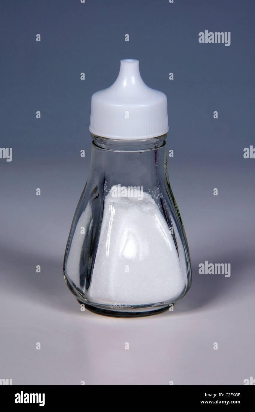 Salt in a glass salt cellar. - Stock Image