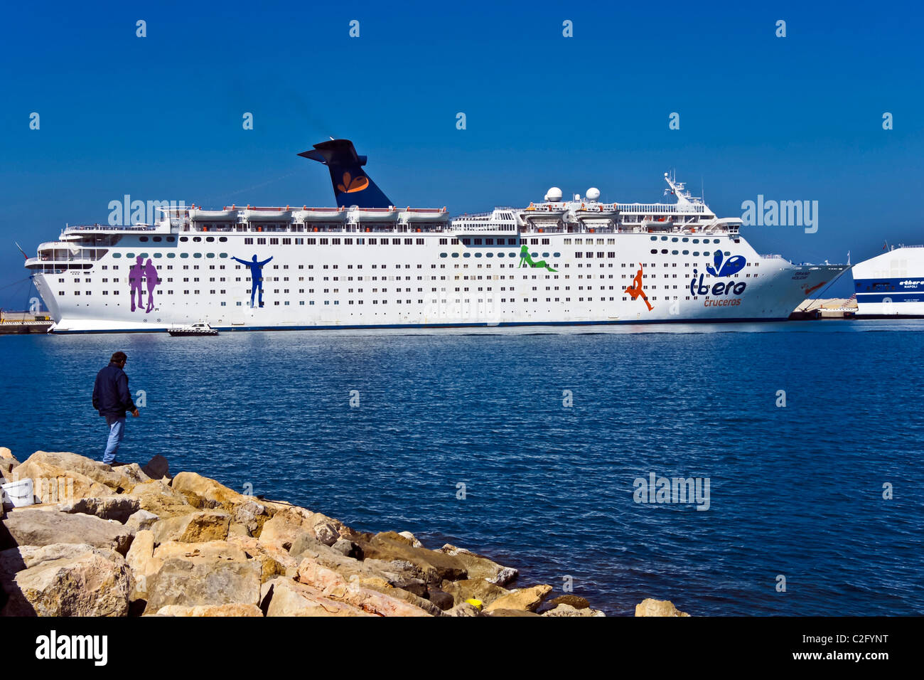 Cruise ship Grand Holiday of Ibero Cruises at Porto Torres in Sardinia Italy. - Stock Image