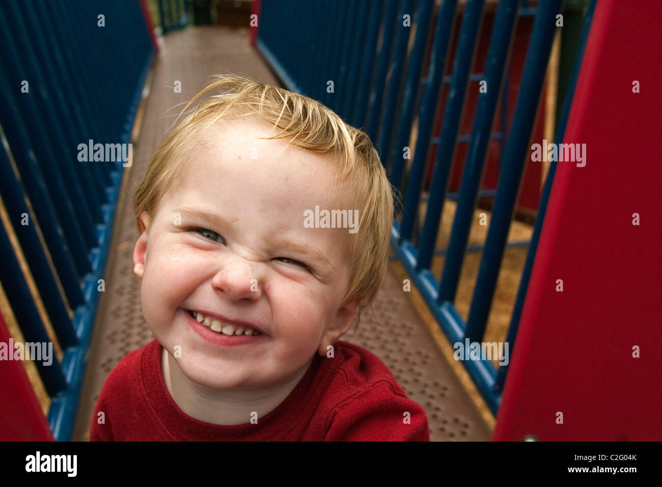 A happy toddler playing at a playground in Alameda, CA Stock Photo