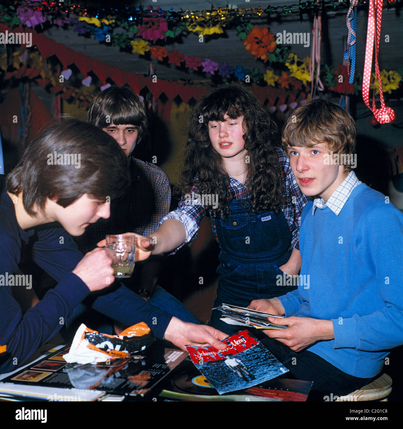 Eighties, people, festivity, juvenile party, cellar party, basement party room, one girl, three boys, aged 14 to - Stock Image