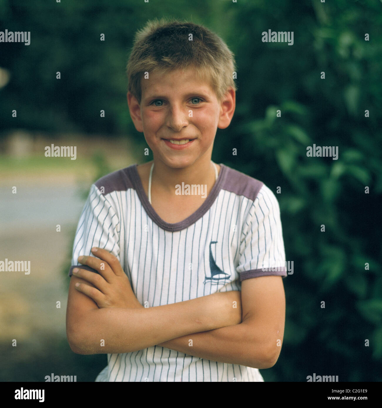 Eighties, people, child, boy, folded arms, portrait, aged 10 to 14 years, short hair Stock Photo