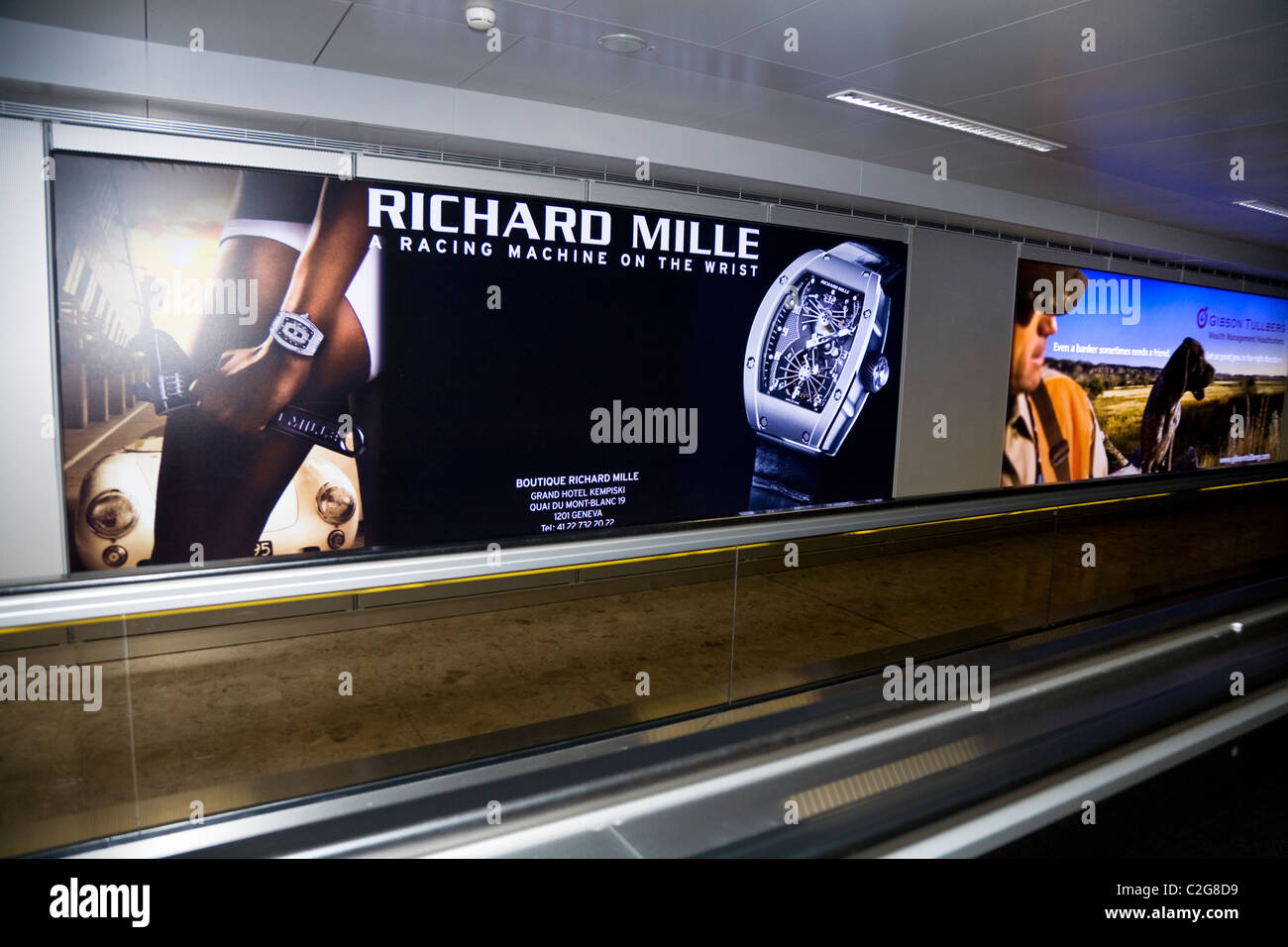 Watch adverts / advert sign / poster at International terminal departure hall, Geneva / Geneve  'Cointrin' - Stock Image
