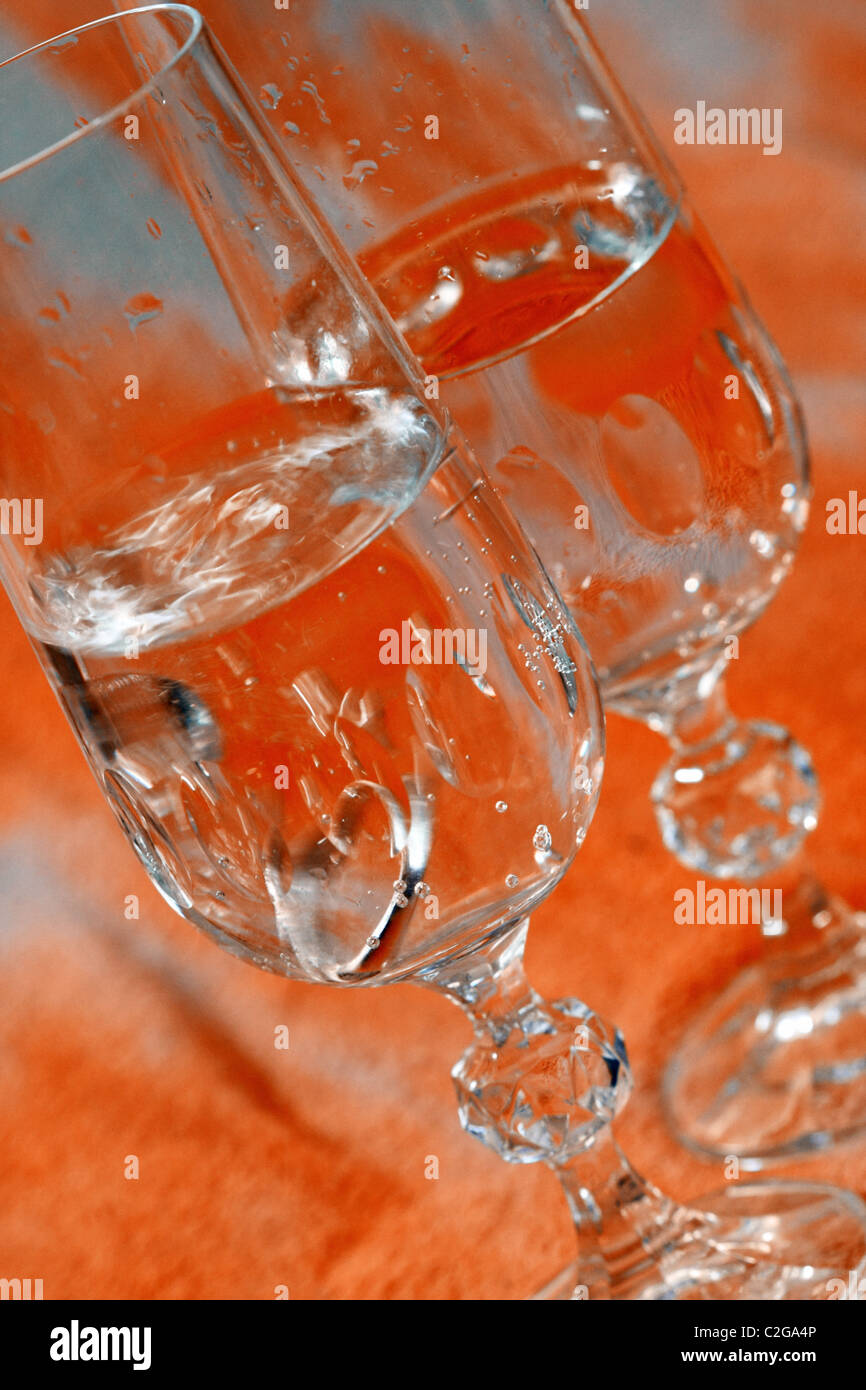 Betrothal ring falling into wine glass - Stock Image