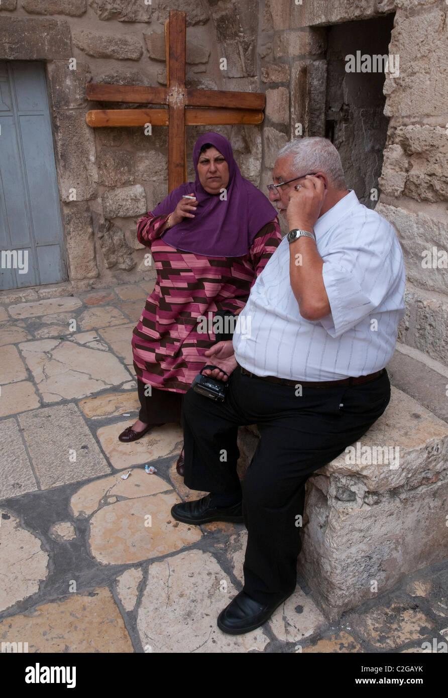 palestinian elderly and overweight couple. Holy Sepulcher. Jerusalem Old City - Stock Image