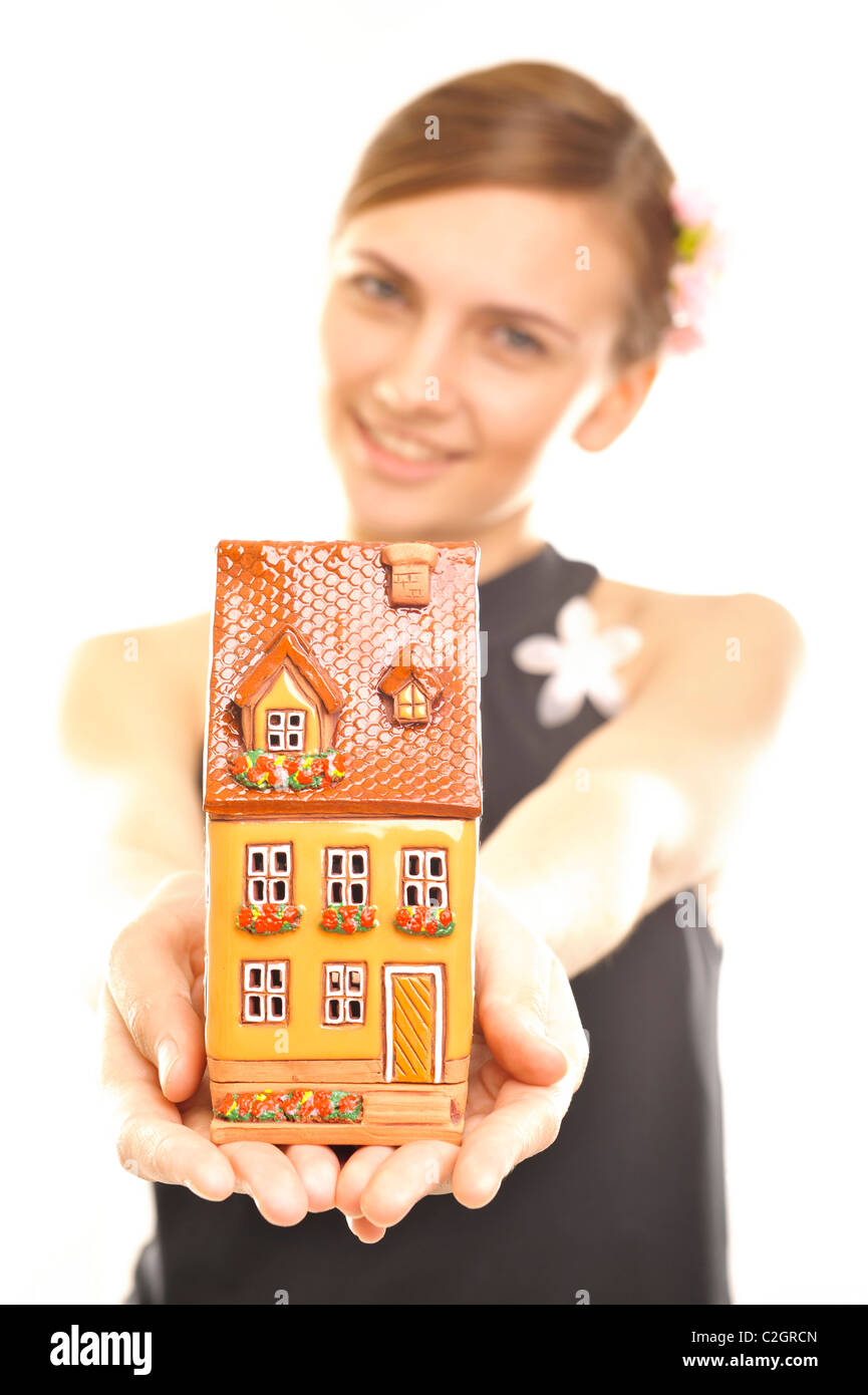 Young beautiful business woman with house model - real estate, mortgage or insurance concept - Stock Image