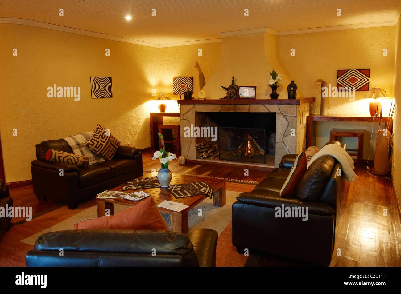 fireplace room in five star luxury Sabyinyo Silverback Lodge, Parc National des Volcans, Virunga Mountains, Rwanda, - Stock Image