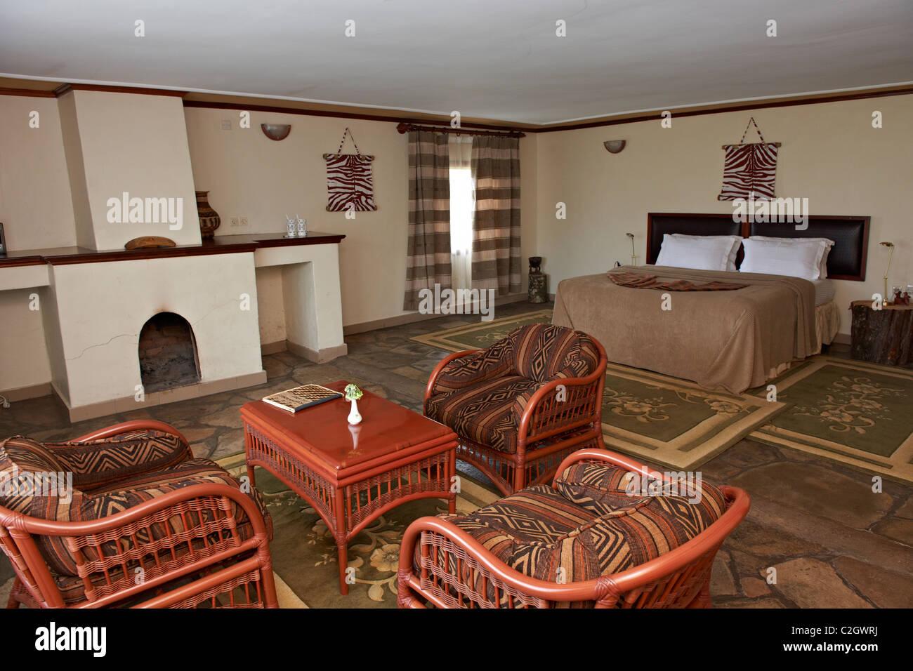sleeping room in Gorilla Mountain View Lodge, Parc National des Volcans, Virunga Mountains, Rwanda, Africa - Stock Image