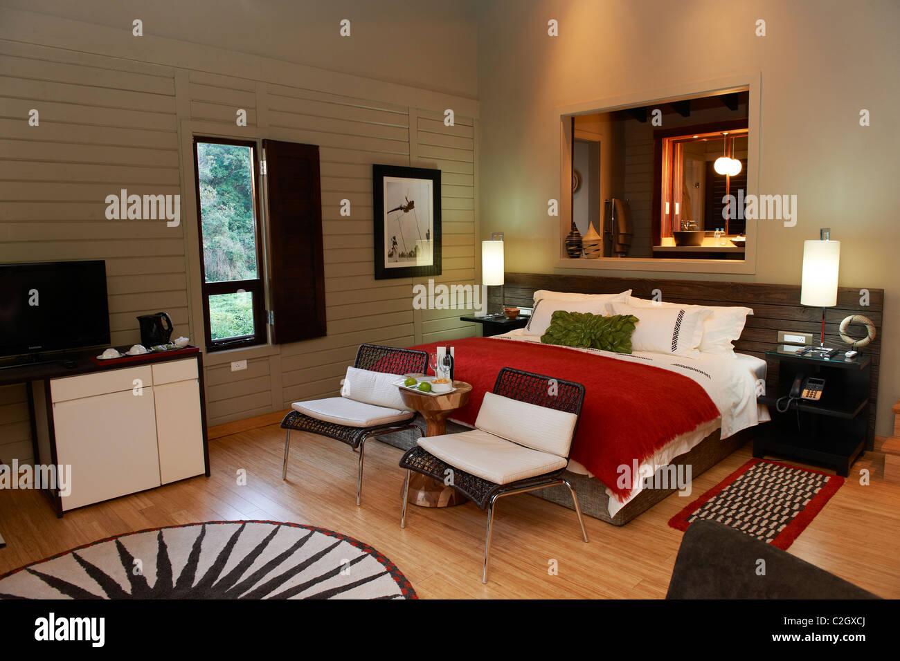 sleeping room in Nyungwe Forest Lodge, Parc National de Nyungwe, Rwanda, Africa - Stock Image
