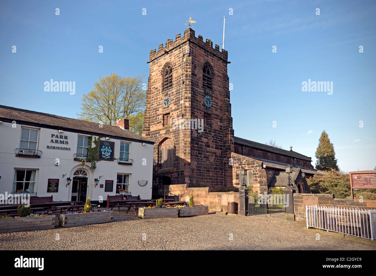 Grappenhall village with St. Wilfrid's church and Parr Arms public house. - Stock Image