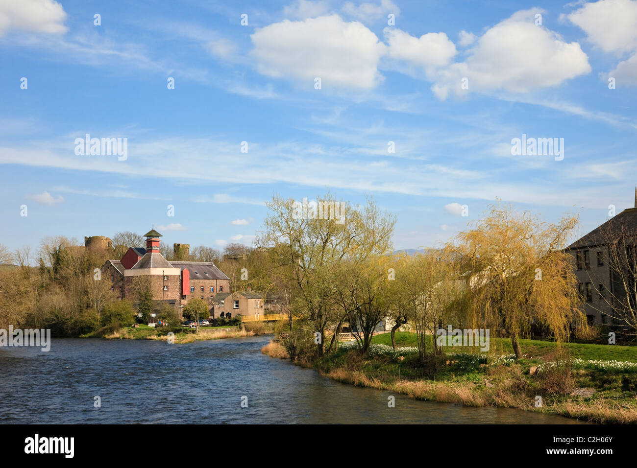 Jennings brewery at the confluence of River Derwent and Cocker. Cockermouth, Allerdale, Cumbria, England, UK, Britain. - Stock Image