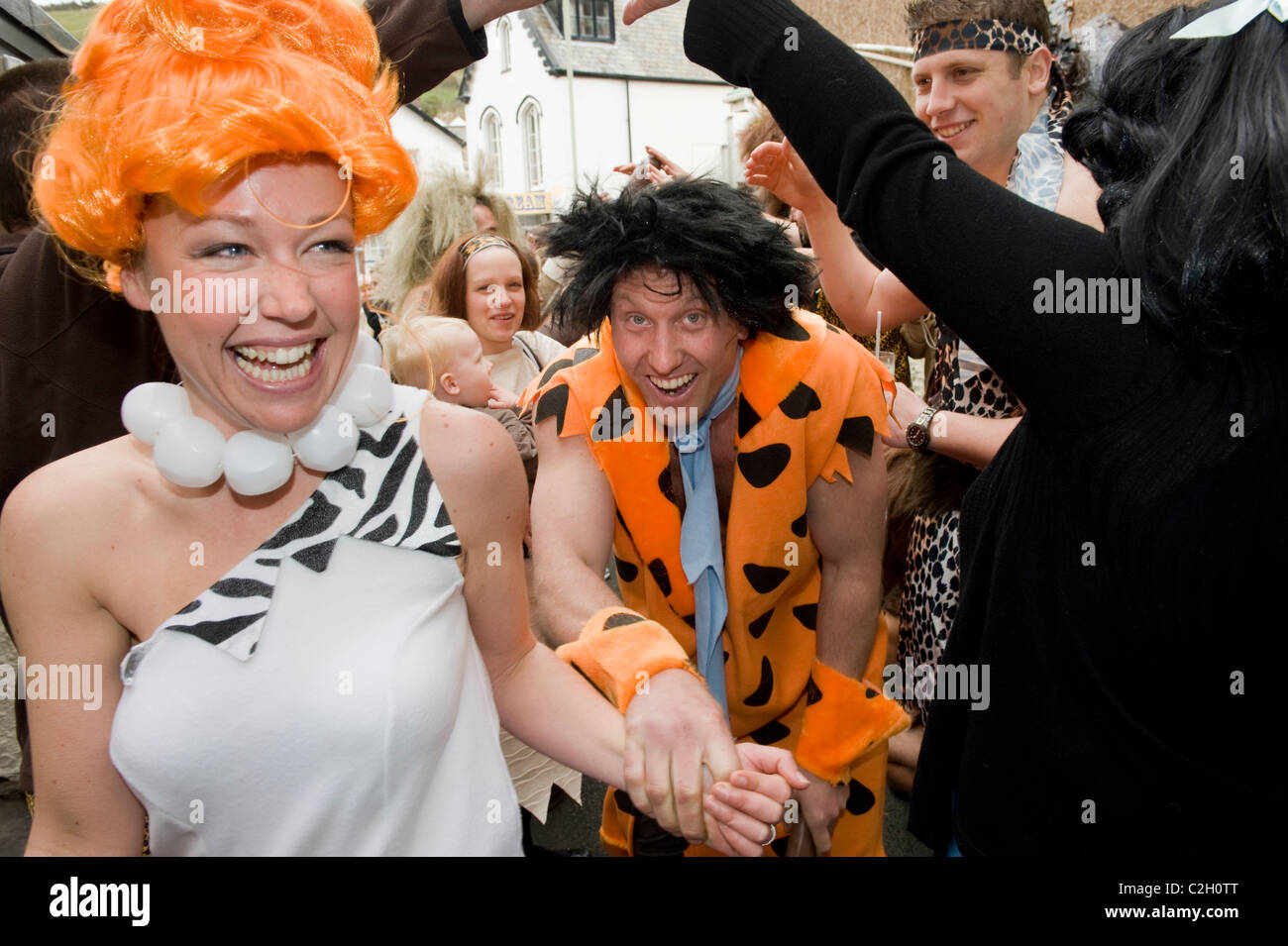 Ed Robinson (34) (Fred)and Gayle Watson (29) (Thelma) at their flintstones themed wedding in Combe Martin, Devon, - Stock Image
