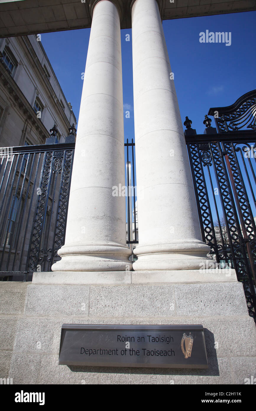 Twin pillars in front of the department of the taoiseach, government buildings, dublin, ireland against a blue sky. Stock Photo