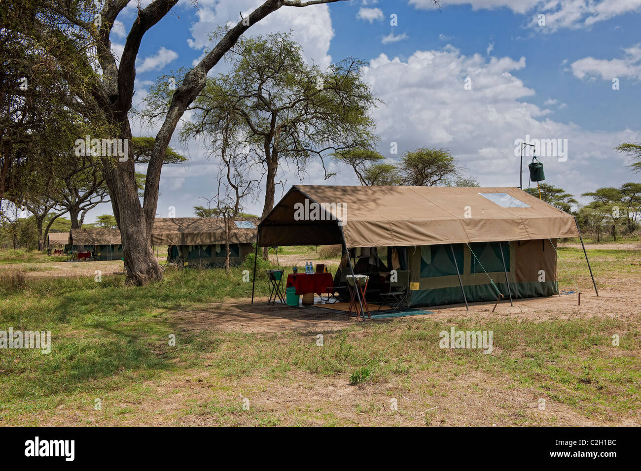 tents in wilderness of Luxury Mobile Safari Tended Camp, Serengeti, Tanzania, Africa - Stock Image