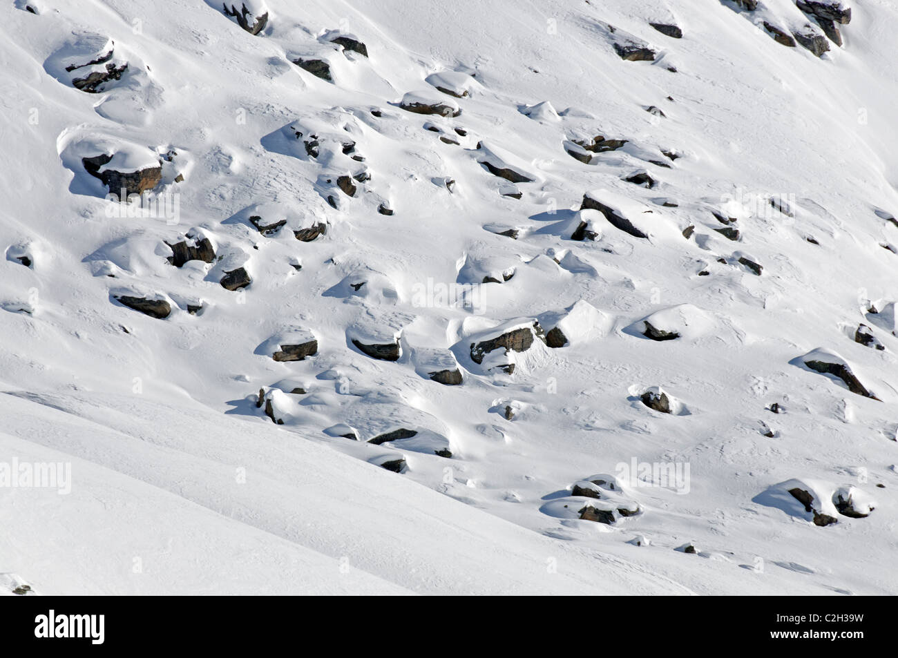 A boulder field covered in snow. Stock Photo
