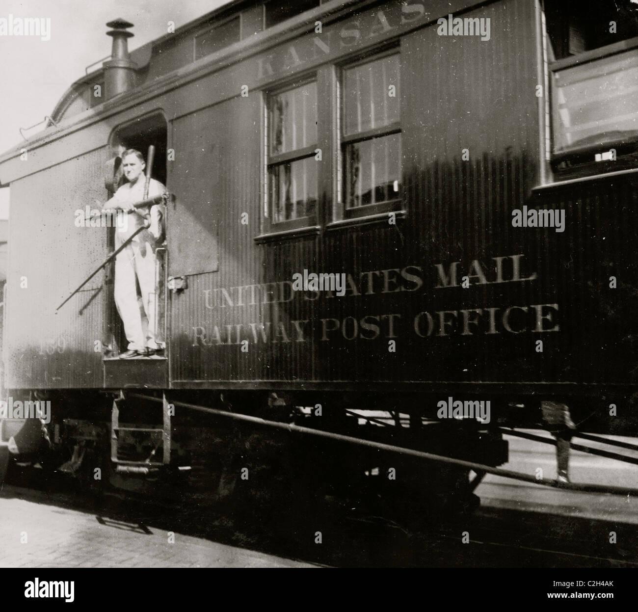 Train Postal Clerk on Railroad Car - Stock Image
