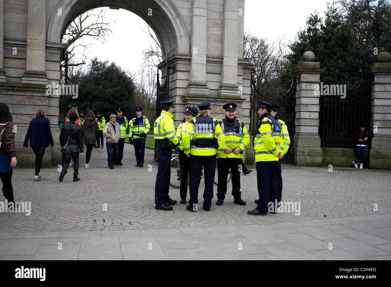 An Garda Siochana outside the entrance gates of St Stephens Green, Dublin, Ireland on St. Patrick's Day. Stock Photo