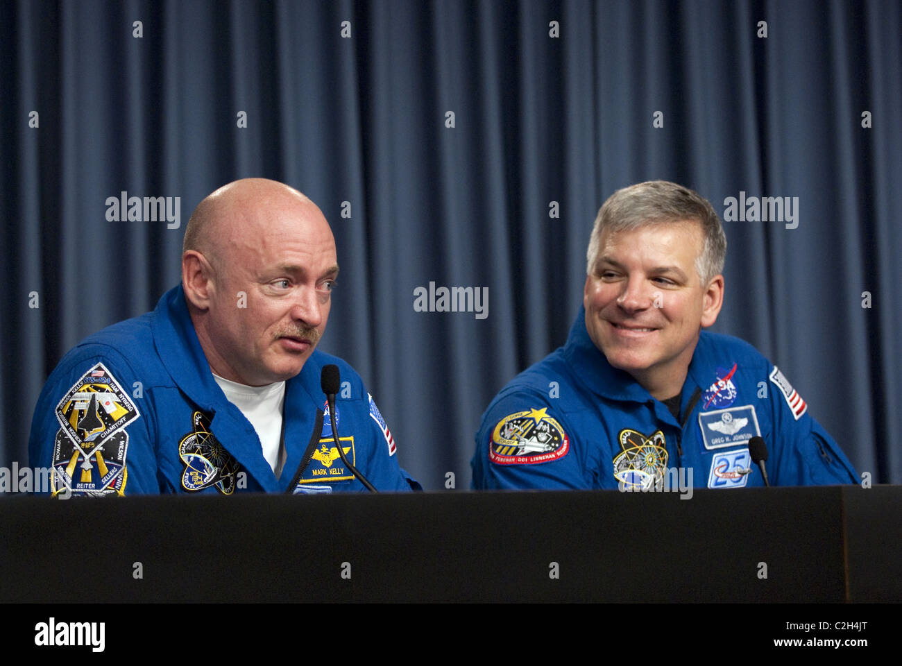 STS-134 Commander Mark Kelly and Pilot Greg H. Johnson - Stock Image