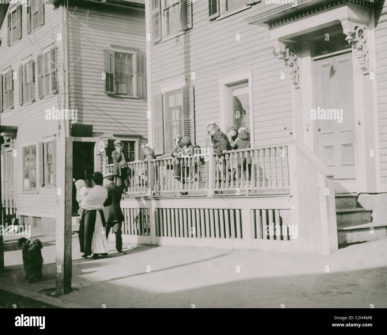 Exterior of Sprague House Settlement Providence, on Saturday morning. The house was so full that these children - Stock Image