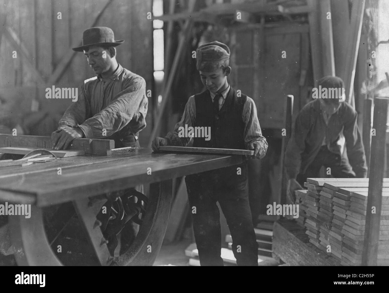 Boys taking away from saws and brading. Schultze, Waltman & Co. Planing Mill - Stock Image