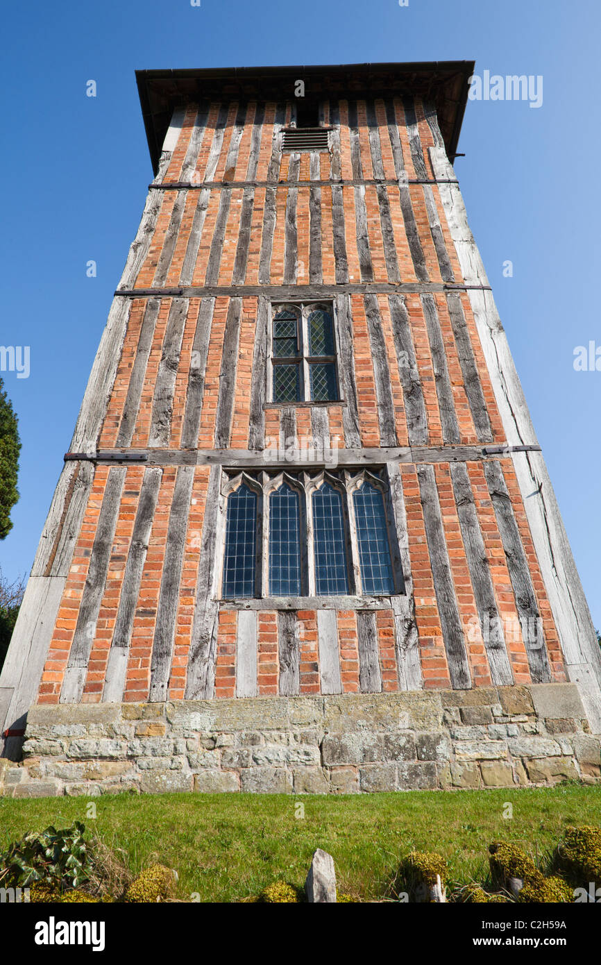 The half timbered tower (c.1500AD) infilled with brick of St Mary the Virgin church at Upleadon, Gloucestershire, - Stock Image
