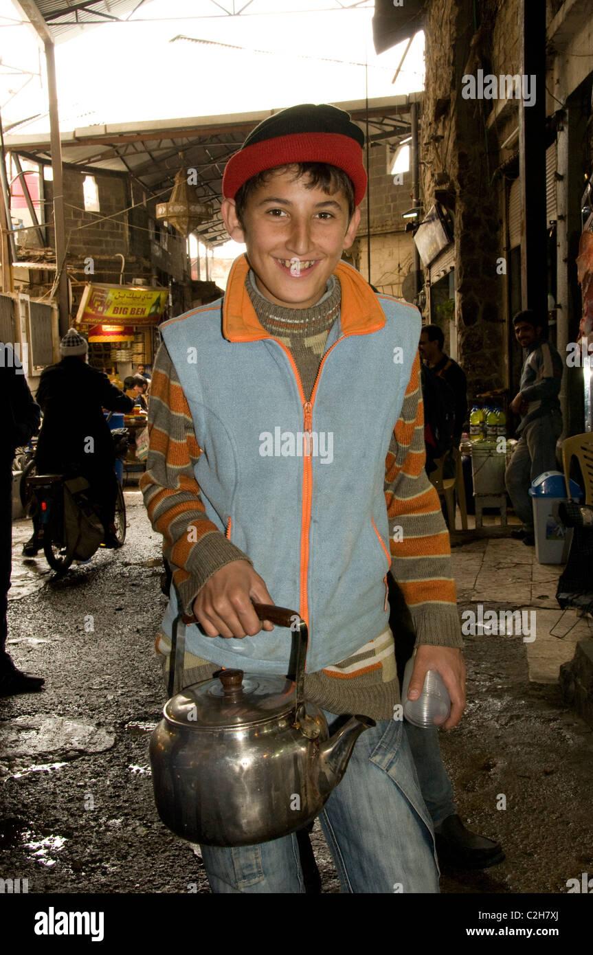 Homs Syria teapot kettle tea pot young boy market - Stock Image