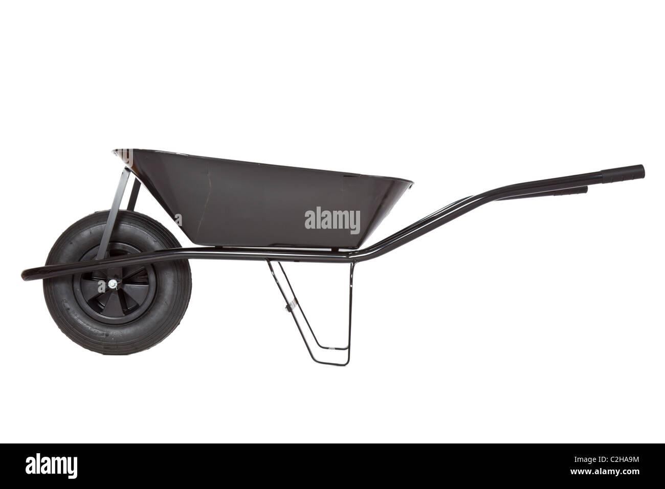 black wheelbarrow on white background - Stock Image
