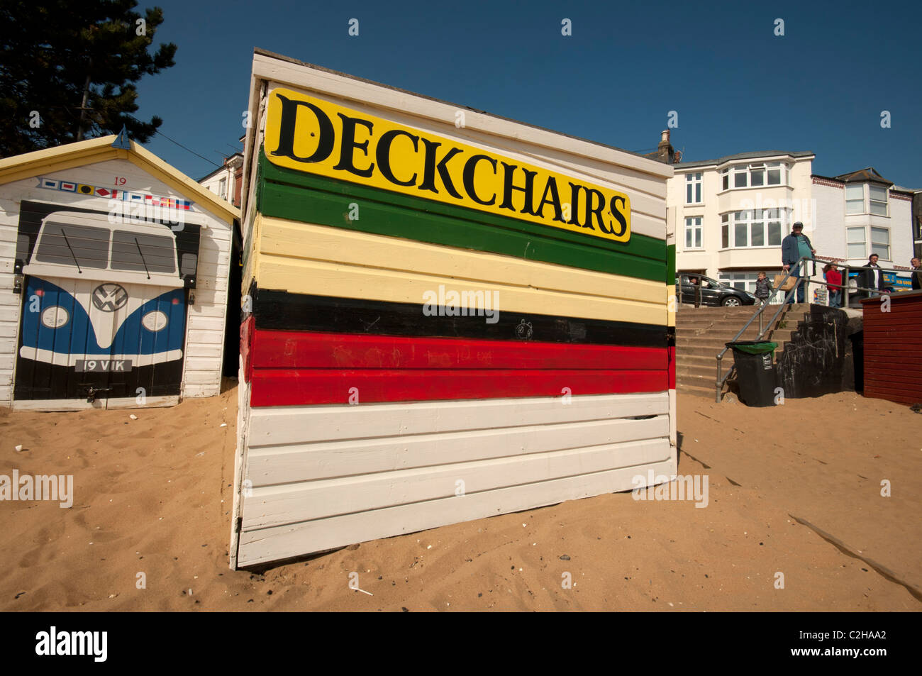 Beach huts with deck chairs for rental at harbour broadstairs Kent UK - Stock Image