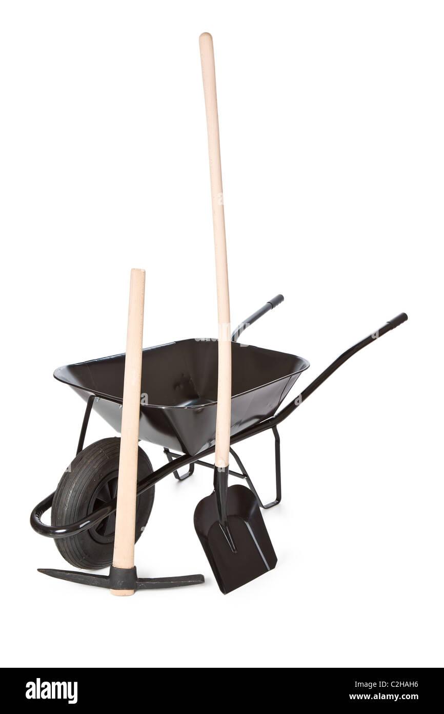 the wheelbarrow with shovel and pick - Stock Image