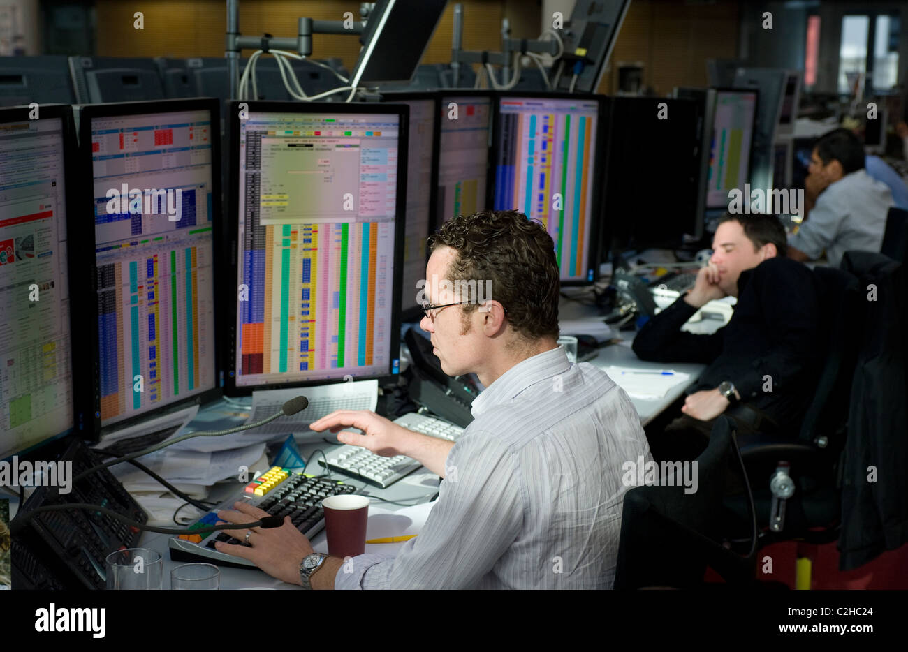 Dealers in securities at the screens of their computers, Frankfurt am Main, Germany - Stock Image