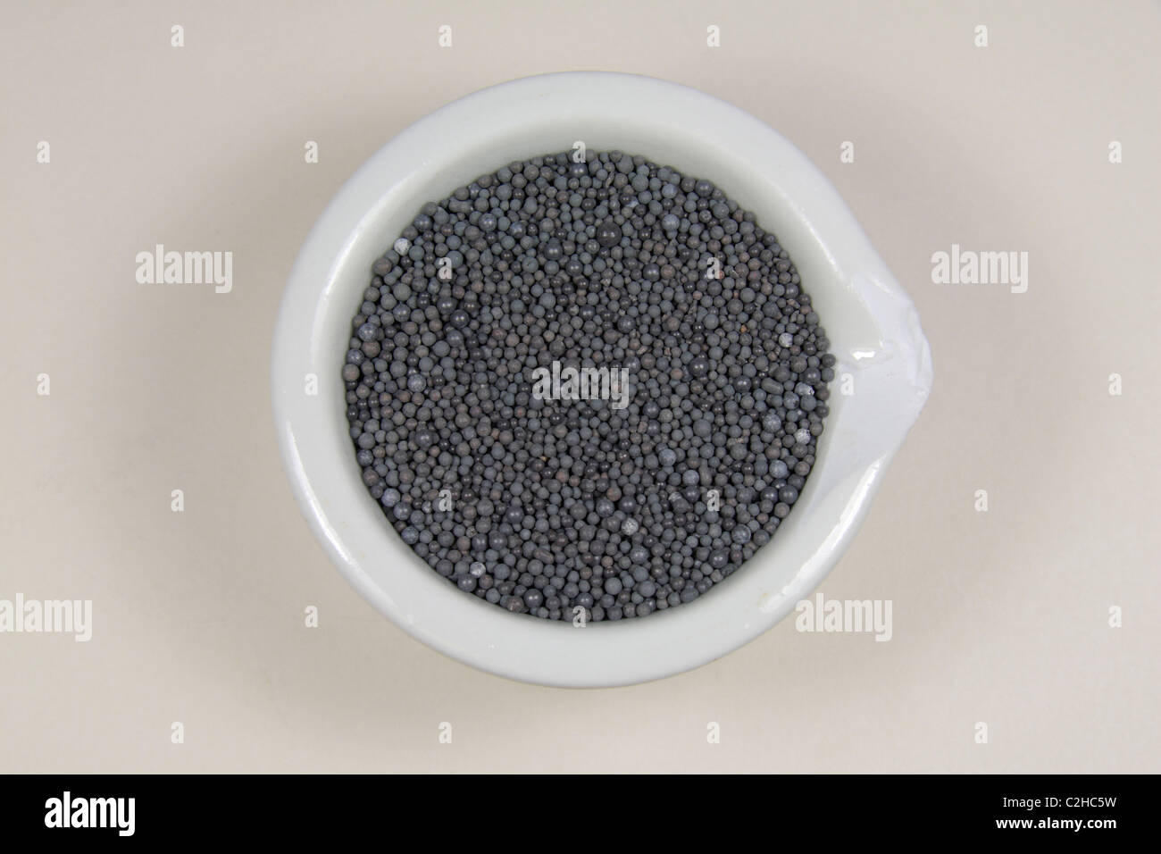 Different uses of lead: lead strip (construction/damp proofing), lead shot and lead piping. - Stock Image