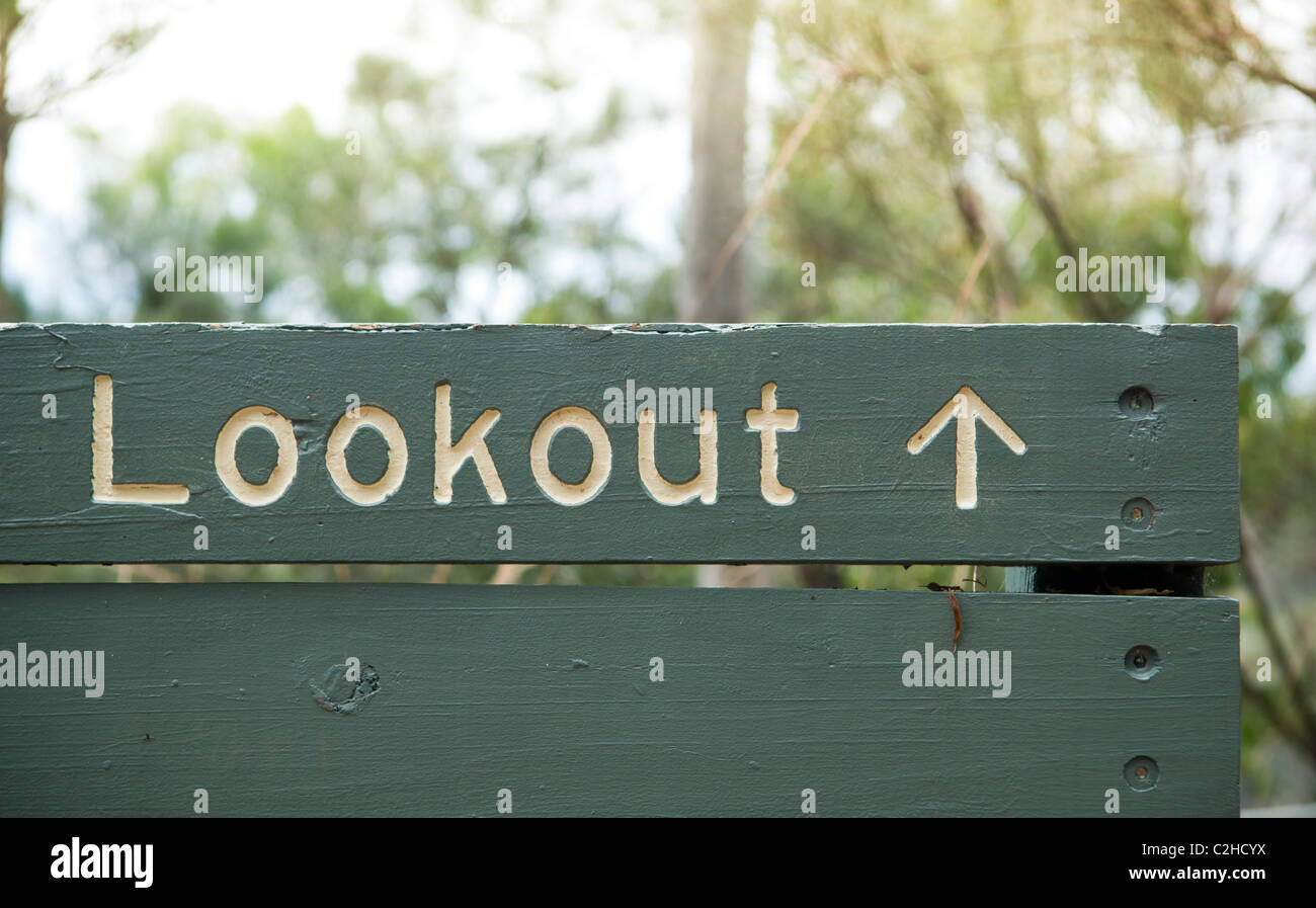 Green wooden sign points towards a lookout - Stock Image