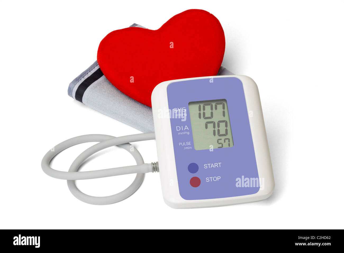 Digital blood pressure meter with love heart symbol on white background - Stock Image