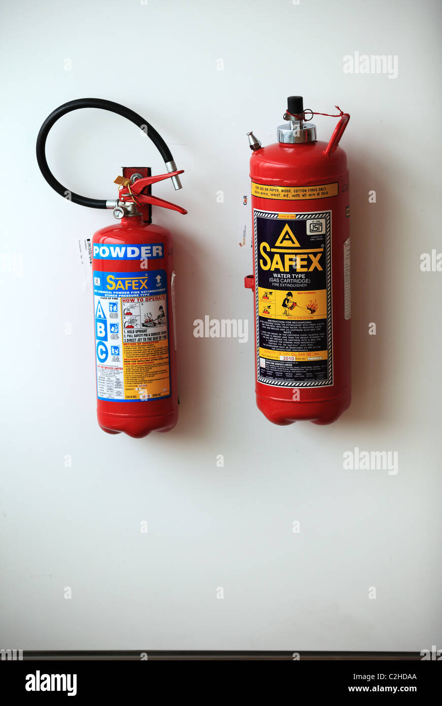 Fire extinguisher at the Delhi airport North India Asia - Stock Image